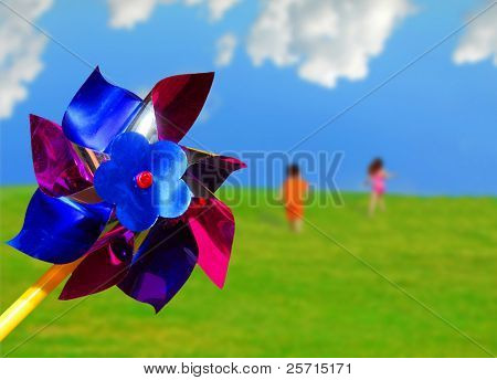 Pinwheel with Children Running up a Hill in the Distance