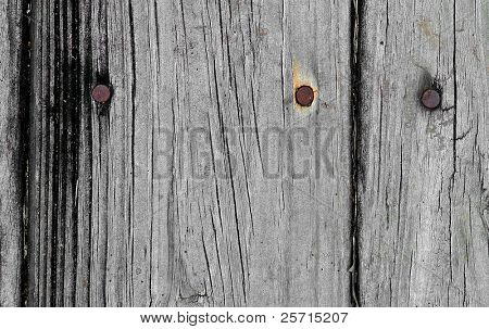 dry wood with rusty nails
