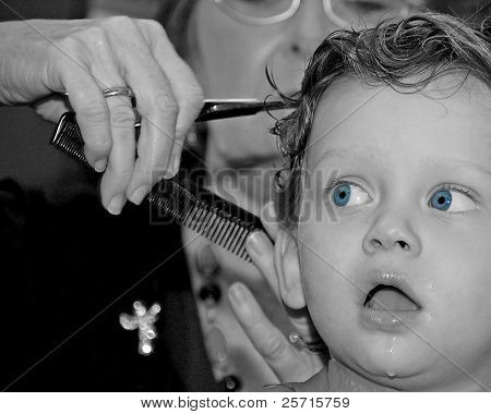 Young Boy Getting Haircut With Funny Stare