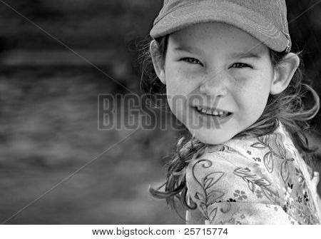 Young Girl Wearing Ball Cap