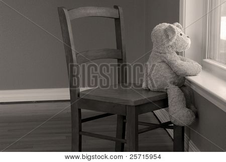 Bear in Chair Looking Out Window