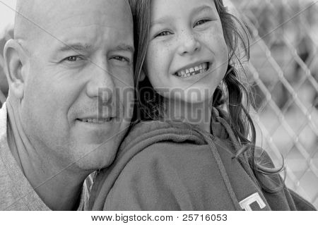 Father and Daughter at Ball Field