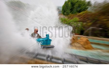 Man Laughing as he Makes Huge Splash on Amusement Park Ride