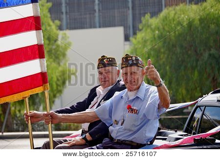 Military Veterans Holding Flags in Parade