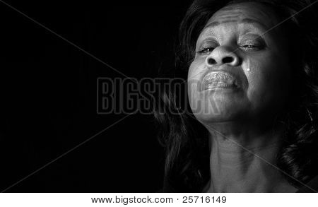 African American Woman With Pained Face and Tear Running Down Cheek