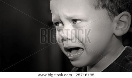 Young Boy with Angry or Frustrated Face