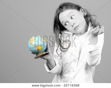 Young Girl Confused While Looking at Globe