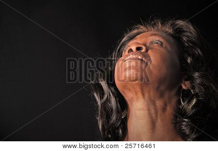 Soulful African American Woman with Head Back in Thoughtful Prayer