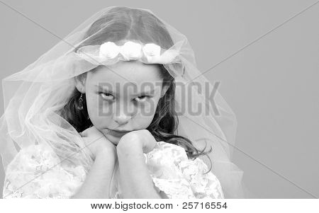 Young Girl in Dress and Veil Looking Unhappy