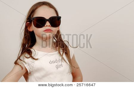 Young Girl in Oversized Glasses with Attitude