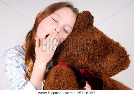 sleepy girl hugging bear