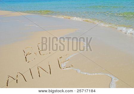 Be Mine Written in Sand on Beach Near Pretty Ocean Surf
