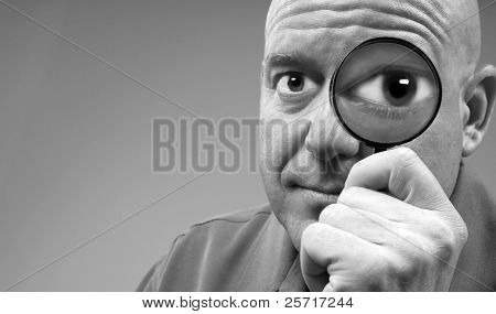 Man Looking Through Magnifier with Huge Eye