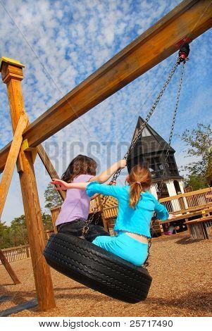 Children Having Fun on Tire Swing