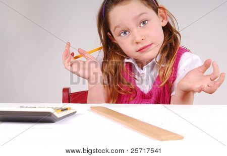 Young Girl Doing Math Looking Confused