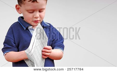 Young Boy Reading Financial Section of Newspaper