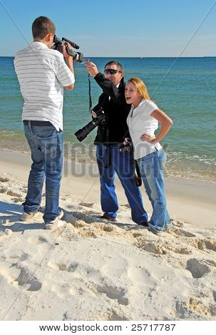 Cameraman and Photographer with Model on Beach