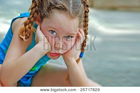 Cute Girl in Pigtail Braids Making Funny Face