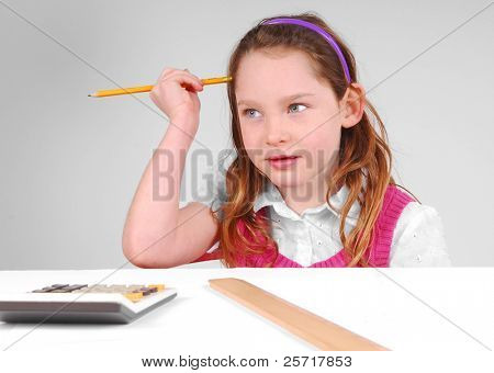 Young Girl Working on Math, Thinking Hard