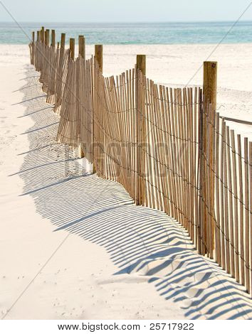 Slatted sand dune fence leading to pretty oceanside beach
