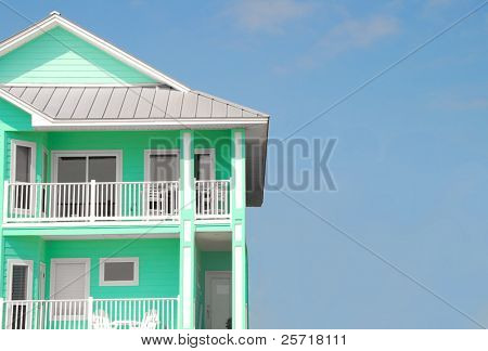 Tropical Home in Bright Color with Tin Roof