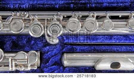Silver flute instrument in plush blue velvet case