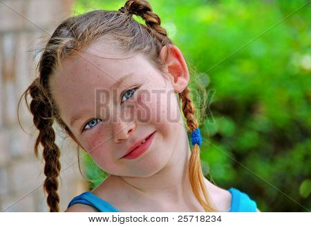 Freckle Faced Girl with Pigtail Braids