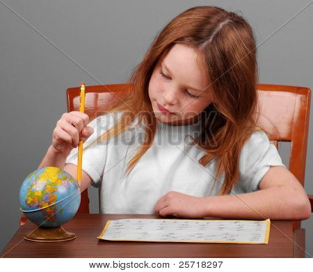 Young girl working on homework assignment at desk