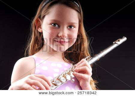 Young girl holding flute, ready to perform