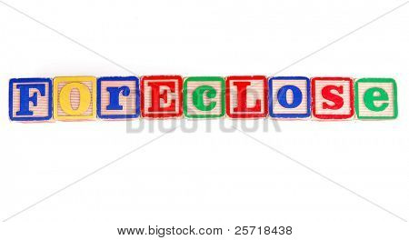 FORECLOSE written in old fashioned childhood wooden blocks