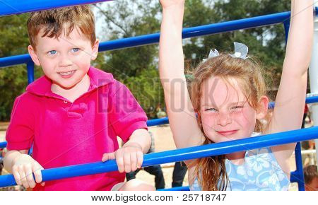 Cute boy and girl on playground outside