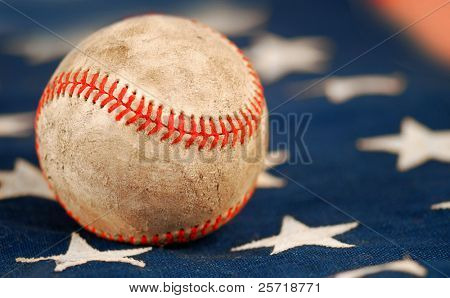 Old and weathered baseball on American flag