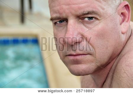 Handsome middle aged athletic man by whirlpool