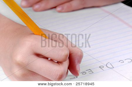 Child practicing ABC's as part of school assignment