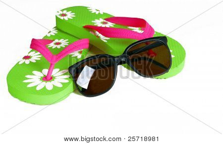 Colorful flip flops with dark sunglasses nearby