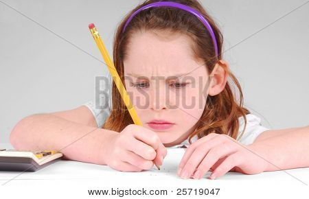 Young girl looking serious while concentrating on work