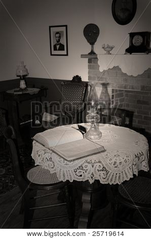 Open Bible on table in old room