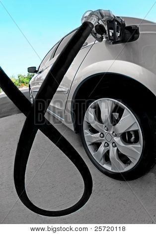 Car getting fuel at gas station