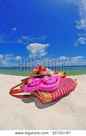 Beach accessories on pretty beach under blue sky