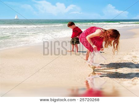 Young girl and boy collecting shells at pretty beach