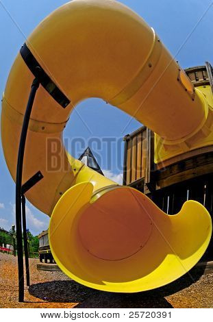 Huge circular tunnel slide on sunny playground