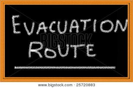 Ruta de evacuación, escrito en la pizarra