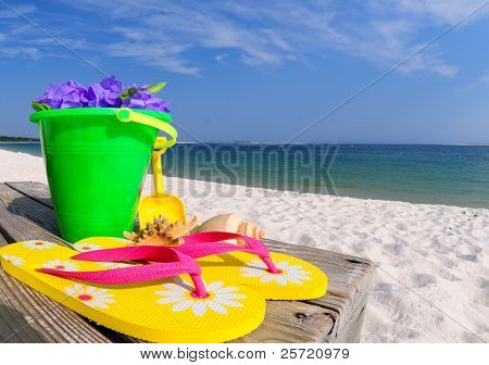 Colorful beach accessories on boardwalk by ocean