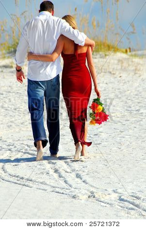 Couple in love leaving beach together