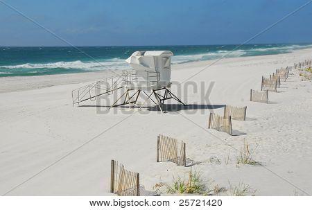 Deserted lifeguard shack on pretty winter beach