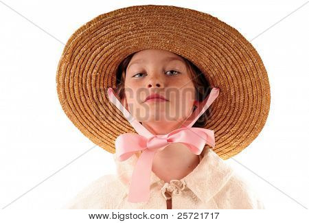 Prim young girl in straw hat