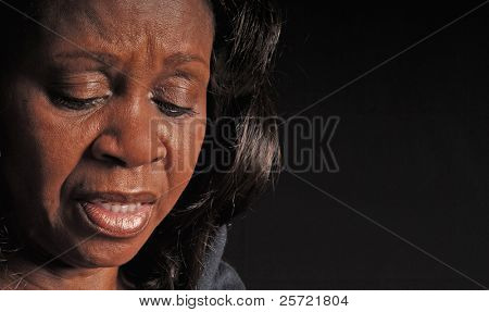 Attractive black woman looking concerned or upset