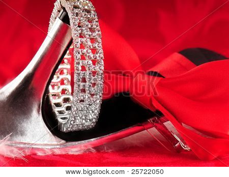 High heeled shoe with bracelet and bowtie