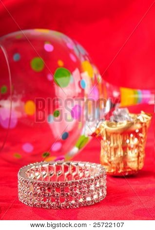 Bracelet, spilled glass, and champagne foil after party