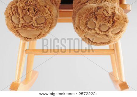 bear feet in wooden rocking chair